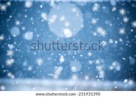 Falling Snow On The Blue Background With Star - stock photo