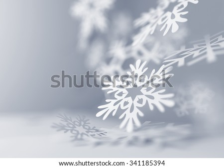 Falling Snowflakes. Paper craft snowflakes close up illustration of falling snowflakes. Christmas winter background. - stock photo