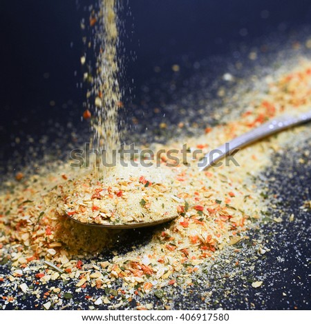 Falling spices on spoon - stock photo