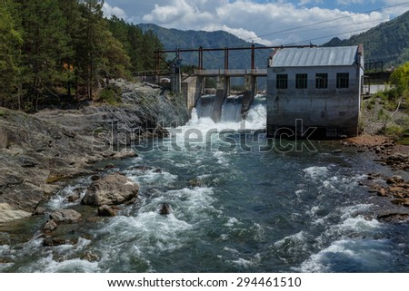 Falls on the mountain river hydroelectric power station