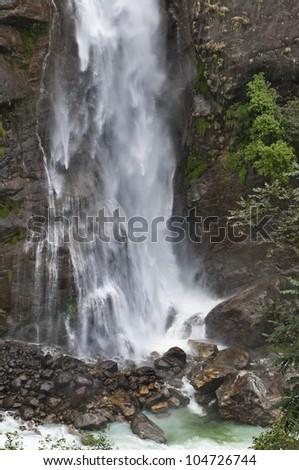 Falls on the steep rock in the Himalayan mountain. - stock photo