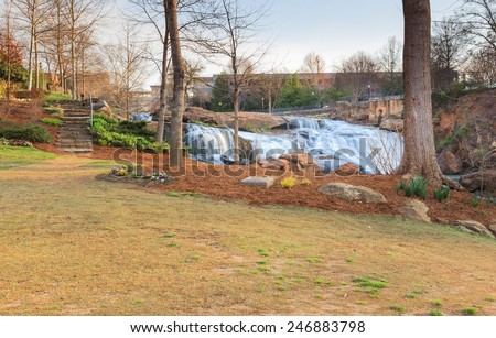 Falls Park in downtown Greenville, South Carolina, where the Reedy River Waterfalls cascade through the middle of town. - stock photo