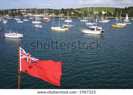 Falmouth boats and union flag - stock photo