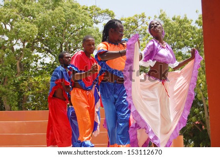 FALMOUTH, JAMAICA - June 18: Dancers greet guests from the Royal Caribbean Cruise. June 18, 2013 in Falmouth, Jamaica - stock photo