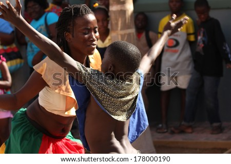 FALMOUTH, JAMAICA � MAY 11: An unidentified street performer dancing outside the port of Falmouth on MAY 11, 2011 in Jamaica ahead of the national labor day celebrations. - stock photo
