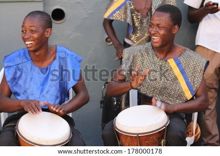 FALMOUTH, JAMAICA � MAY 11: An unidentified street performers playing outside the port of Falmouth on MAY 11, 2011 in Jamaica ahead of the national labor day celebrations. - stock photo