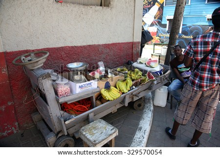 FALMOUTH, JAMAICA SEPTEMBER 27, 2015 : An unidentified man Sells Fruits and Vegetables from his push cart outside the port of Falmouth Jamaica on September 27, 2015. - stock photo