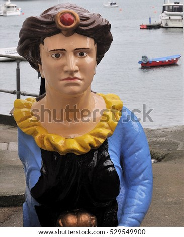 FALMOUTH, UK - OCTOBER 29, 2016. A ship's figurehead by the quayside in Falmouth, a town and port in the English county of Cornwall, UK.