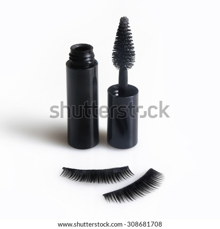 False lashes and black mascara isolated on white - stock photo