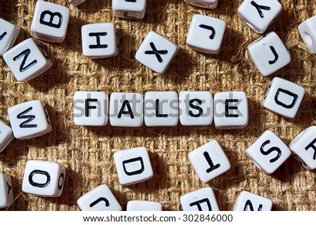 False word on white blocks concept - stock photo