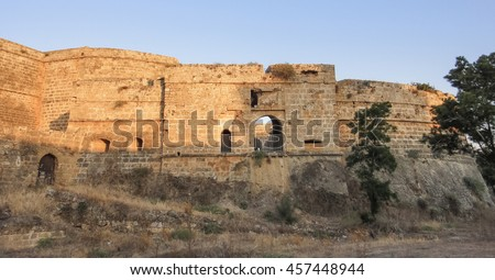 Famagusta medieval fortress (castle and citadel) at sunset. Old town Arsinoe and Ammochostos. Cyprus island