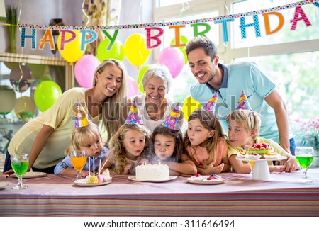 Families with a child at a birthday party - stock photo