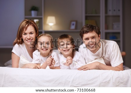 Families with children at home in the evening - stock photo