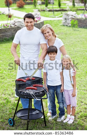 Families with children make barbecue - stock photo