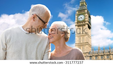 family, age, tourism, travel and people concept - happy senior couple over big ben clock tower in london