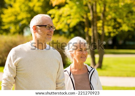 family, age, tourism, travel and people concept - senior couple in city park