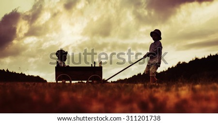 Family amusement with a carriage on the evening - stock photo
