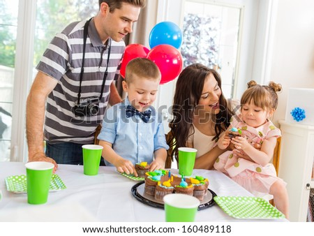 Family and children celebrating birthday party at home