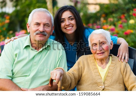 Family and doctor teaming up for the well-being of the senior woman. - stock photo