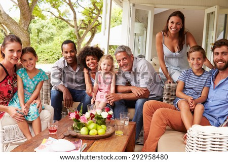 Family and friends posing for a picture in a conservatory - stock photo