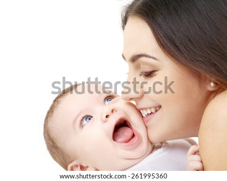 family and happy people concept - mother kissing her baby