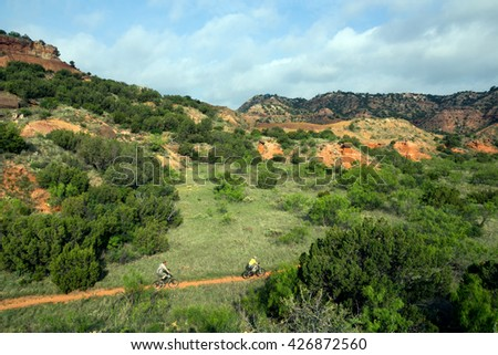 Family are traveling on the trail biking. Palo Duro Canyon State Park, Texas, US