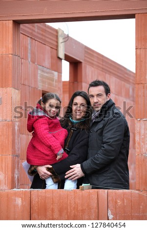 Family at construction site - stock photo