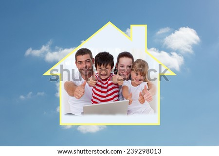 Family at home using a laptop with thumbs up against cloudy sky