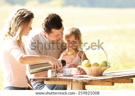 Family at picnic in nature - stock photo