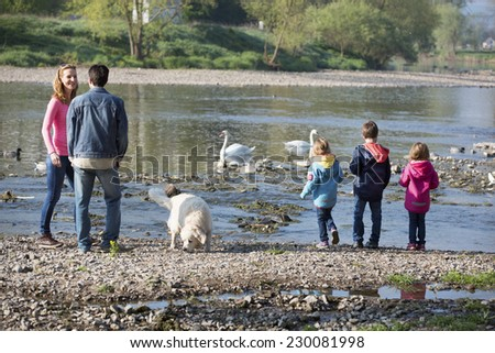 Family at the river - stock photo