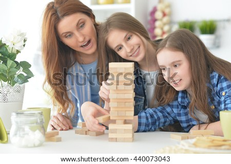 Family at the table playing board game