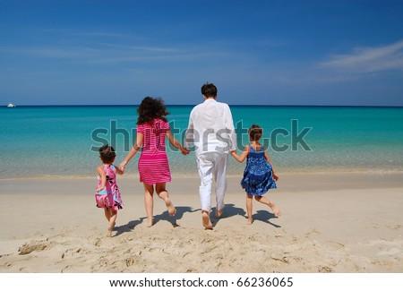 Family beach vacation - stock photo