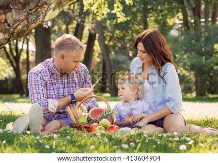 Family being together on vacation having a picnic on fresh air.