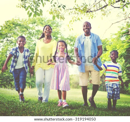Family Bonding Happiness Park Outdoors Concept - stock photo