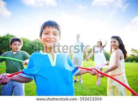 Family bonding in a park. - stock photo