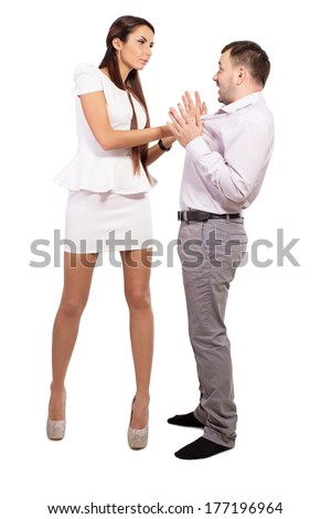 Family boss berates his men. Interaction in the business team. Woman director and a man slave. The relationship between a man and a woman. Woman demands an explanation for an act done with husband. - stock photo