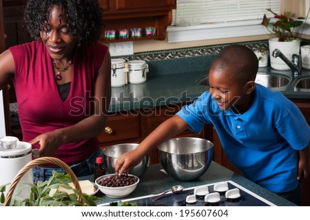 Family: Boy Reaches For Chocolate Chips - stock photo