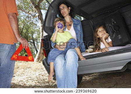 Family Brokendown on Road - stock photo