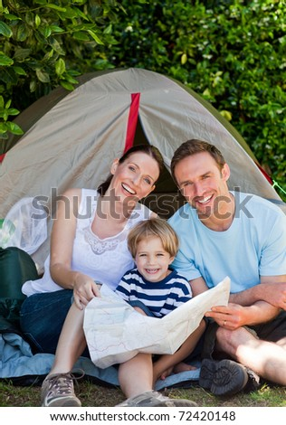 Family camping in the garden - stock photo