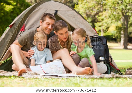 Family camping in the park - stock photo
