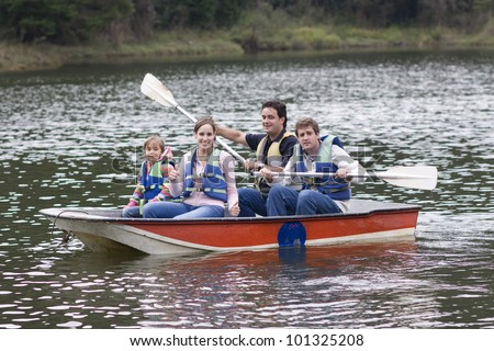 Family Camping Vacation, Uncle, Mother,Father and Daughter Enjoying on Lake - stock photo