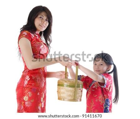 Family celebrating chinese new year - stock photo