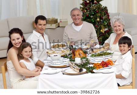 Family celebrating Christmas dinner at home - stock photo
