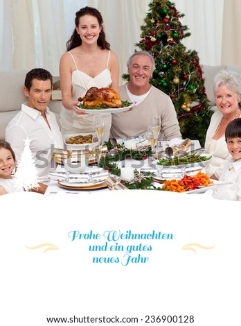 Family celebrating Christmas dinner with turkey against border - stock photo