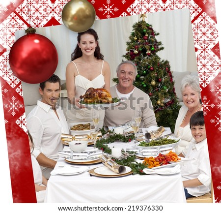 Family celebrating Christmas dinner with turkey against christmas themed page - stock photo