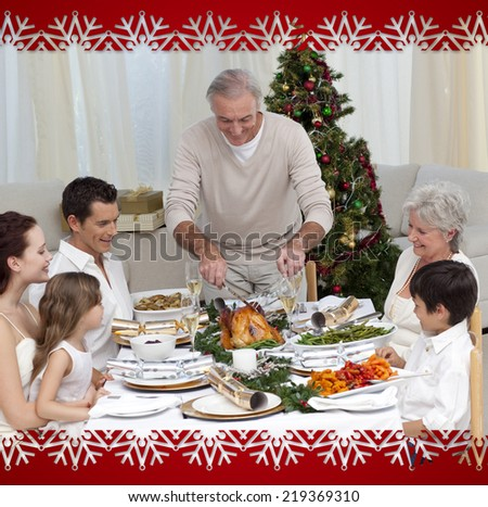 Family celebrating Christmas dinner with turkey at home against snowflake frame