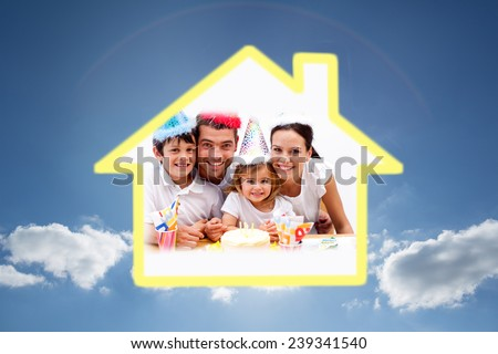 Family celebrating daughter against cloudy sky with sunshine - stock photo