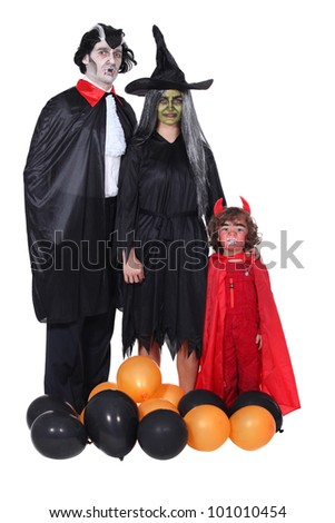 family celebrating Halloween