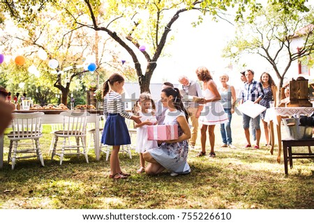 Family Celebration Or A Garden Party Outside In The Backyard.
