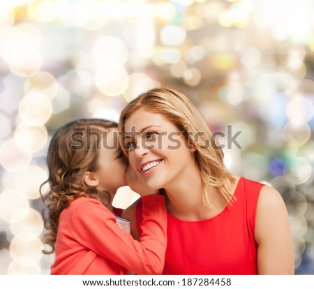 family, child and happiness concept - smiling mother and daughter whispering gossip - stock photo